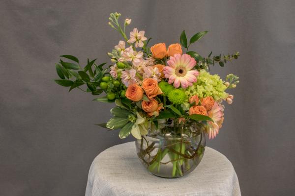 Bacheloresque - $49.00 orange spray roses, peach gerbs